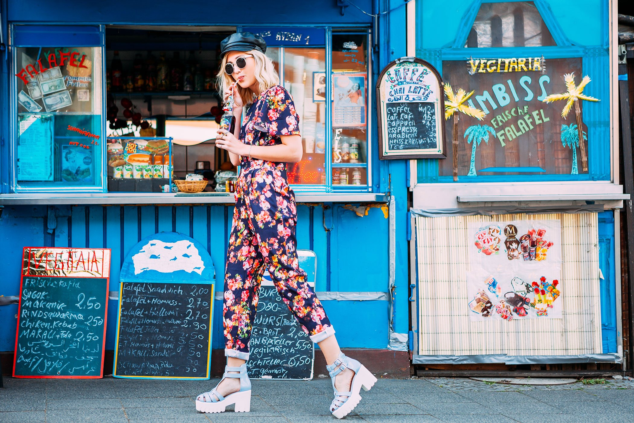 mikuta with flower jumpsuit at the kiosk